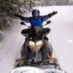 Marta Sprout snowmobiling in Canada